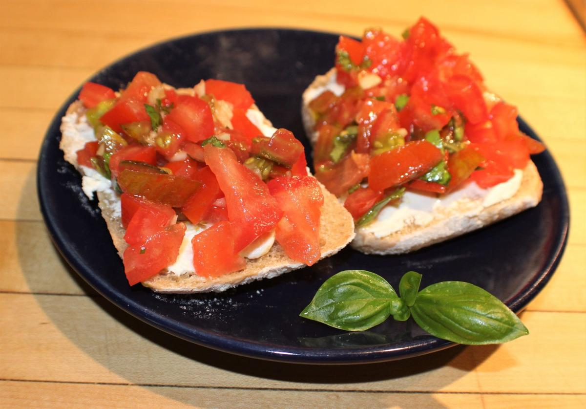 this bruschetta is topped with fresh garden tomatoes combined with garlic olive oil and basil - Olive Garden Kenosha