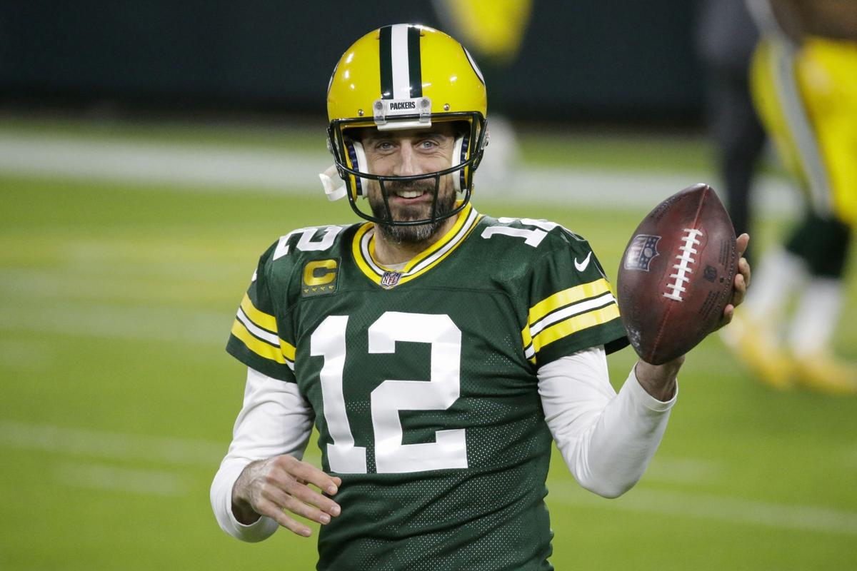 Aaron Rodgers smiling with ball, AP generic file photo