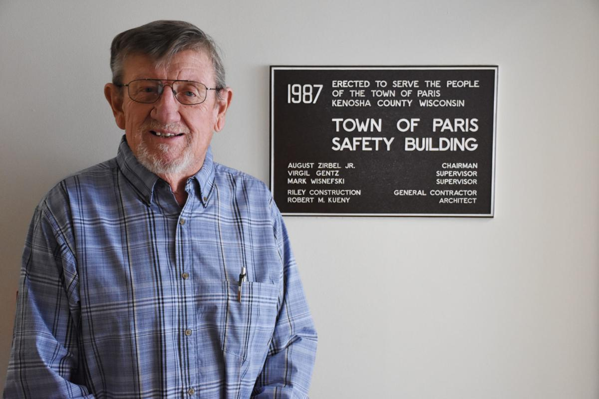 0cb01dab231d9 Virgil Gentz stands with a 1987 plaque commemorating the construction of  the town of Paris Safety Building. Gentz
