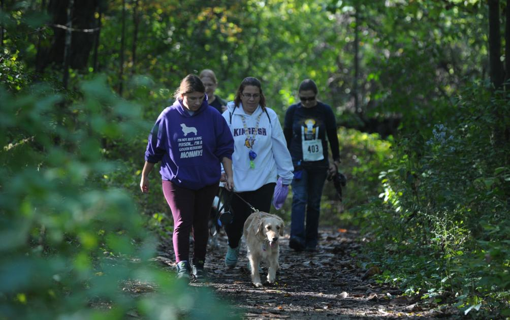 Dogs, humans enjoy day of fun and frolicking at annual Walk for Paws