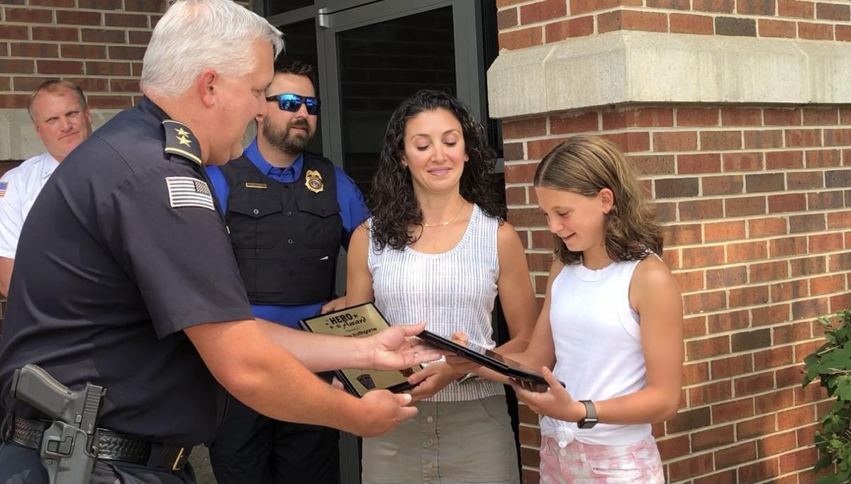 TLPD Chief Adam Grosz presents plaque