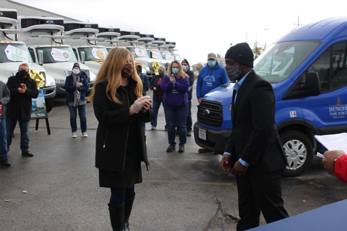 Sharon Pomaville accepts keys to van