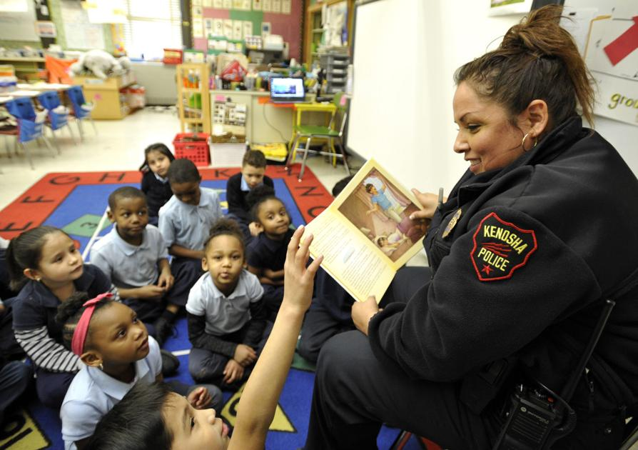 Officers' visit to Wilson Elementary nets funny stories, lots of books