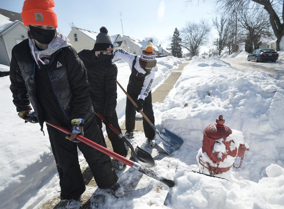 SCOUTS CLEAR HYDRANTS