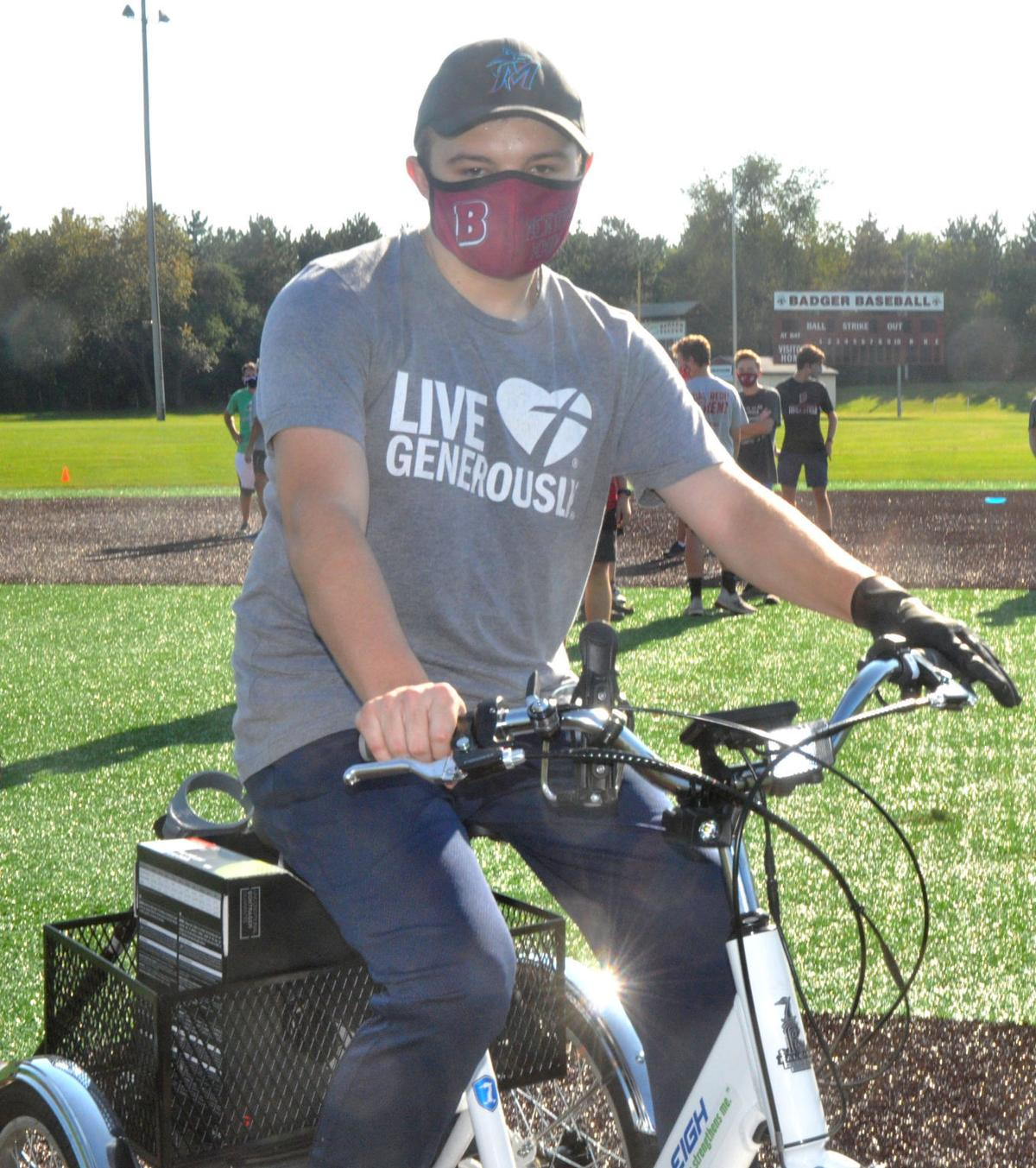 Badger High School student Brooks Guif tries out the new electric bike