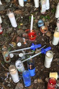Vigil held as probe into shooting death continues