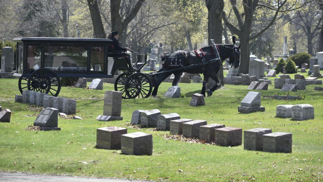 IN PHOTOS: Horse-drawn funeral procession to Green Ridge Cemetery