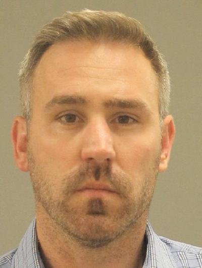 Burlington town official indicted in prostitution sting