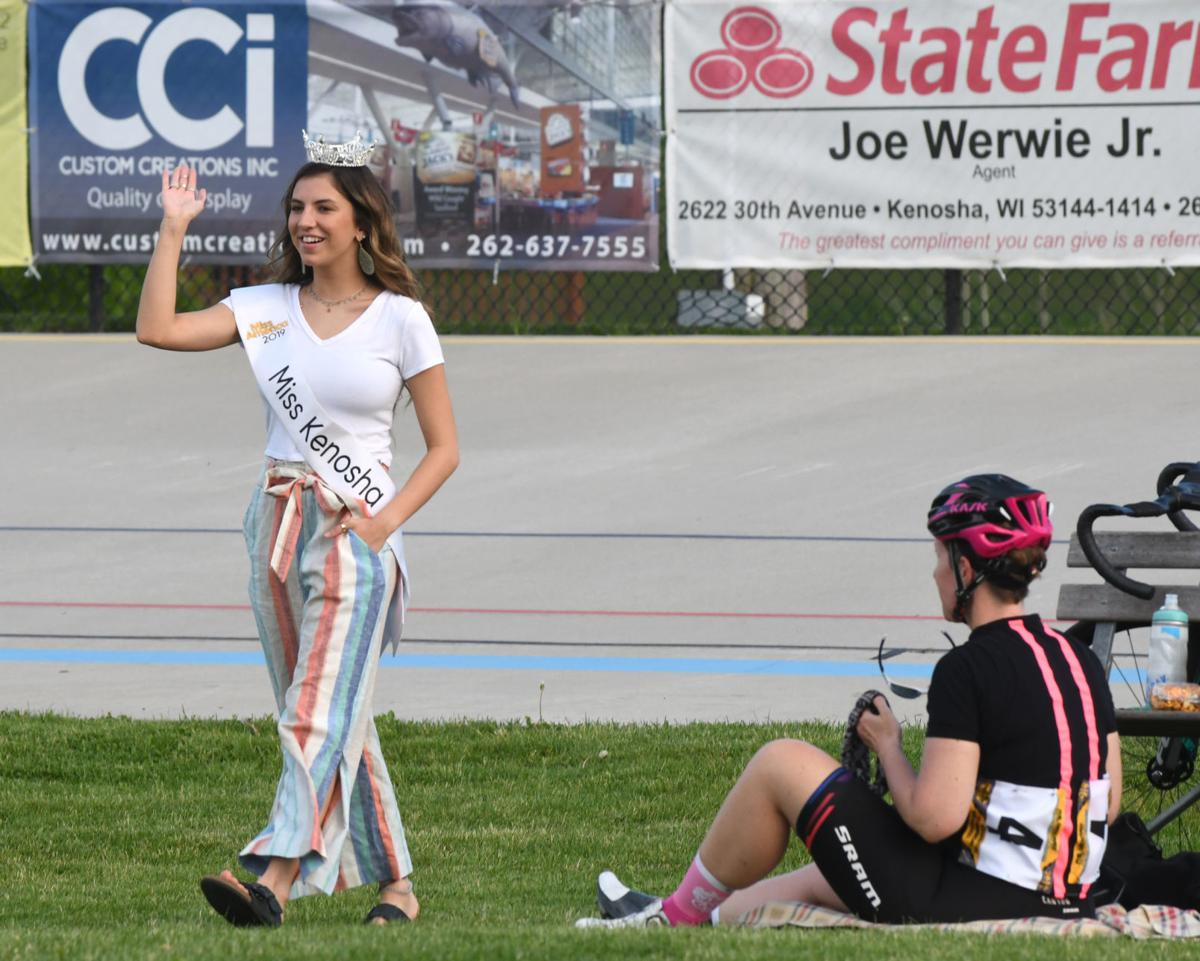 Lily Karnes Miss Kenosha waves at bike races.jpg