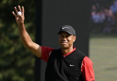Woods picks himself to play in Presidents Cup