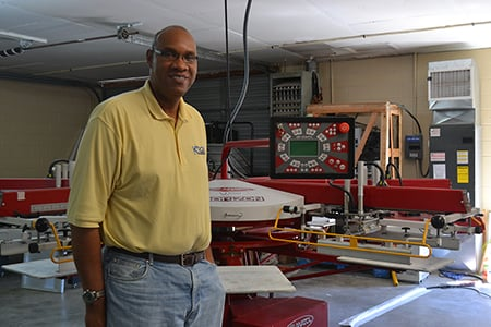 Retired basketball star opens printing shop
