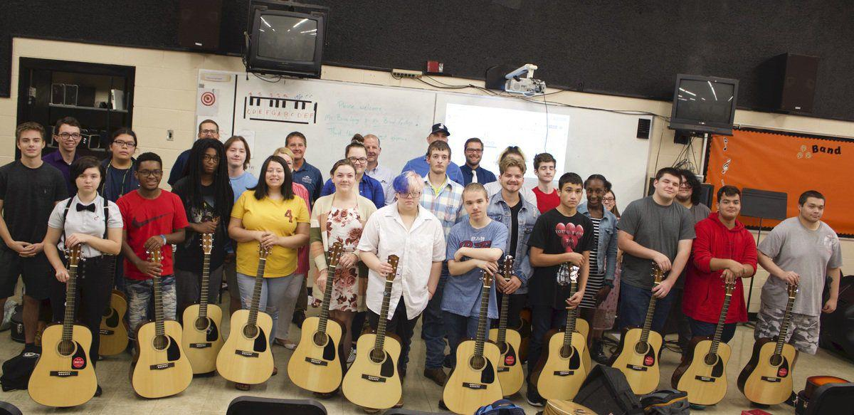 Brice Long donates guitars to HHS