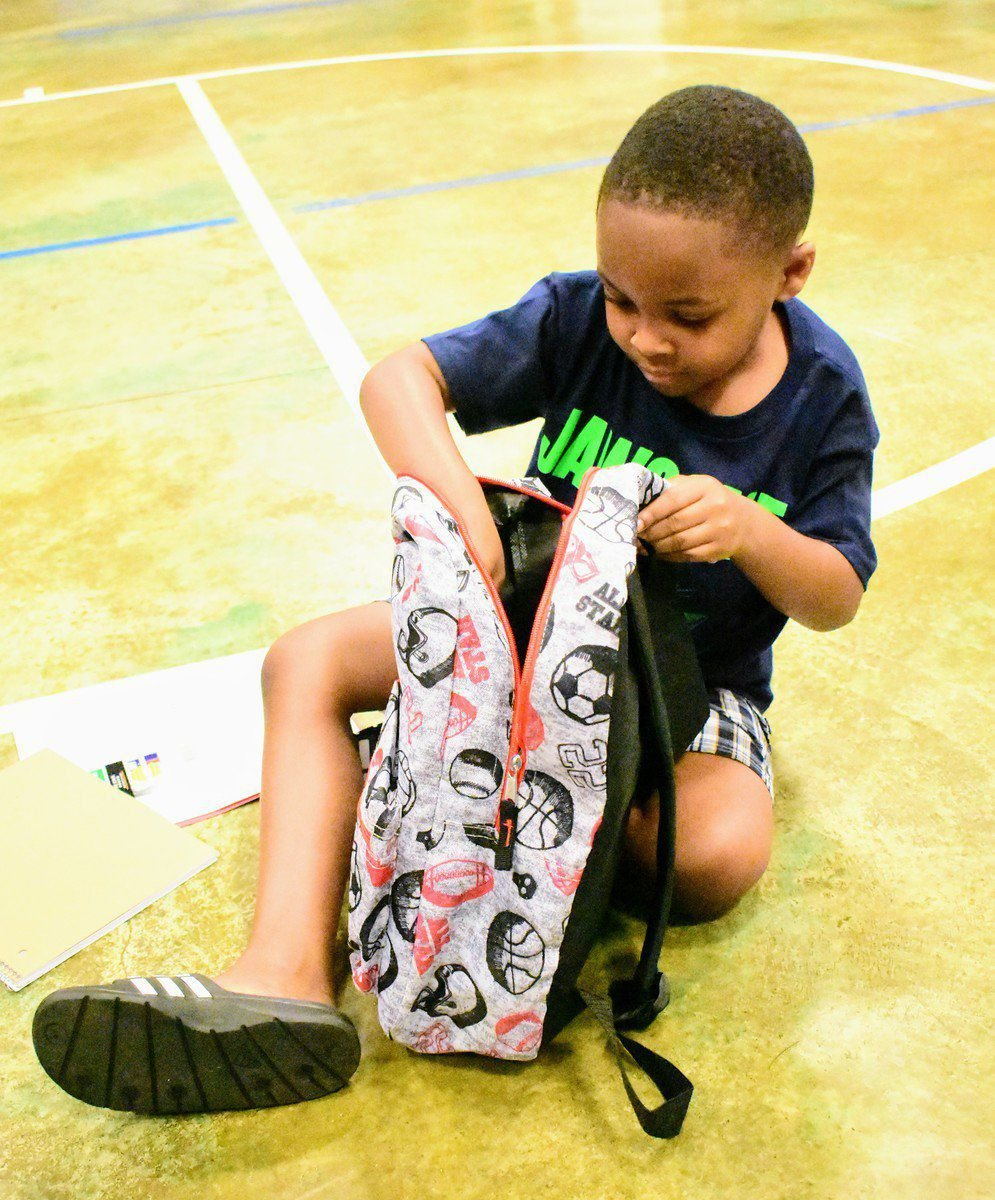 Mission of Hope delivers 180 stuffed backpacks to youth