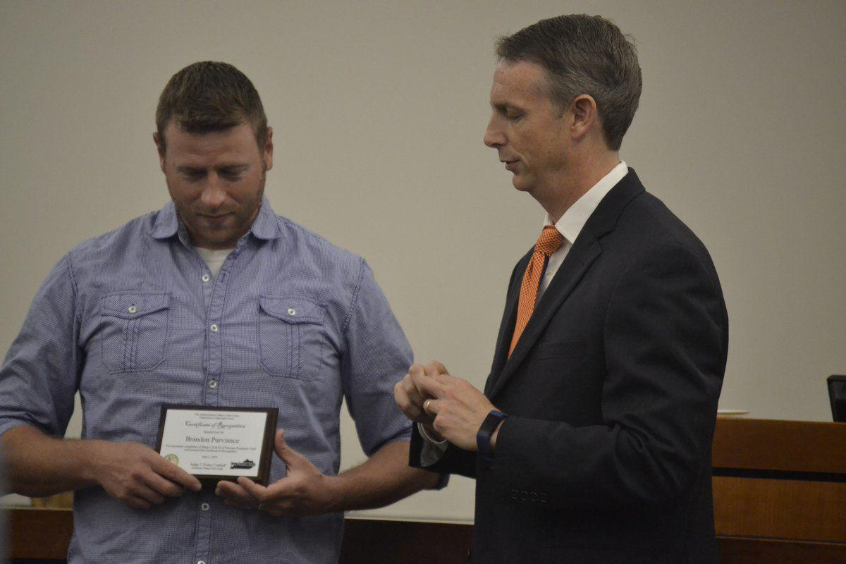 2 men graduate from veterans treatment court