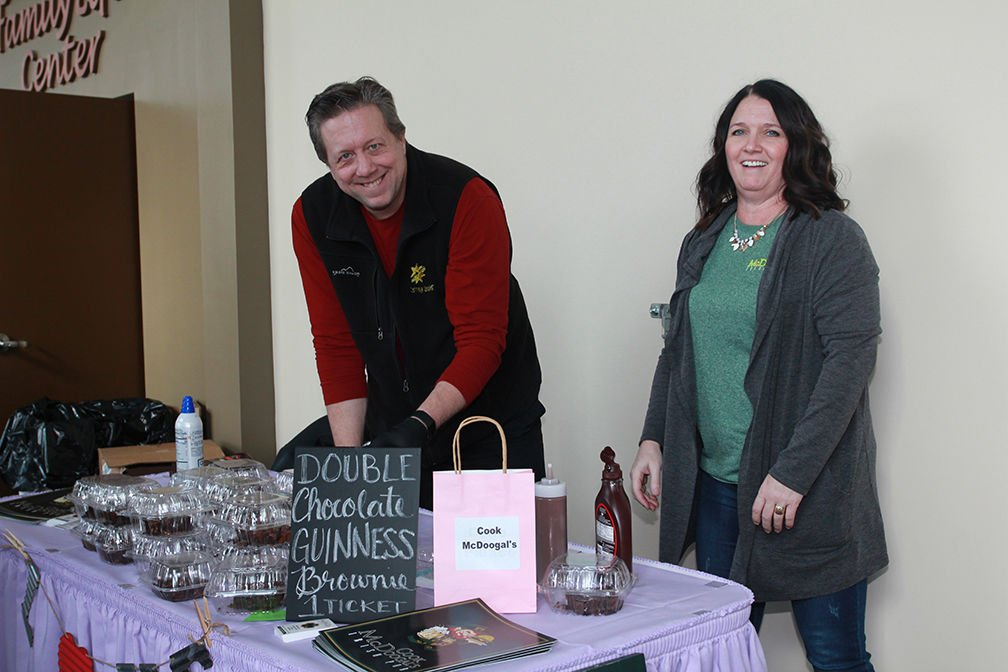 Greg Bentley and Erin Bennett manning the Cook McDoogal's booth.JPG