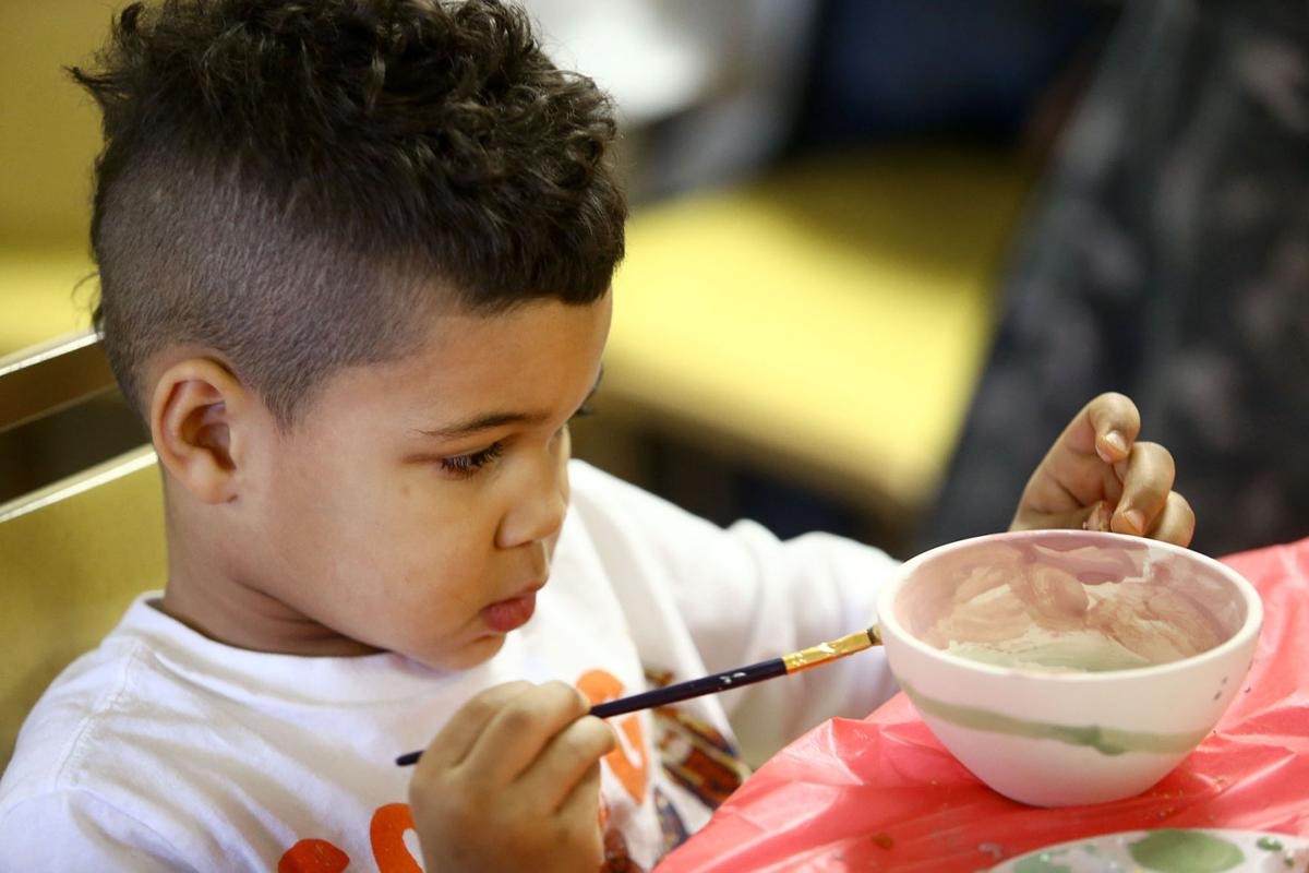 Child Volunteers Paint Bowls To Raise Awareness Of Hunger