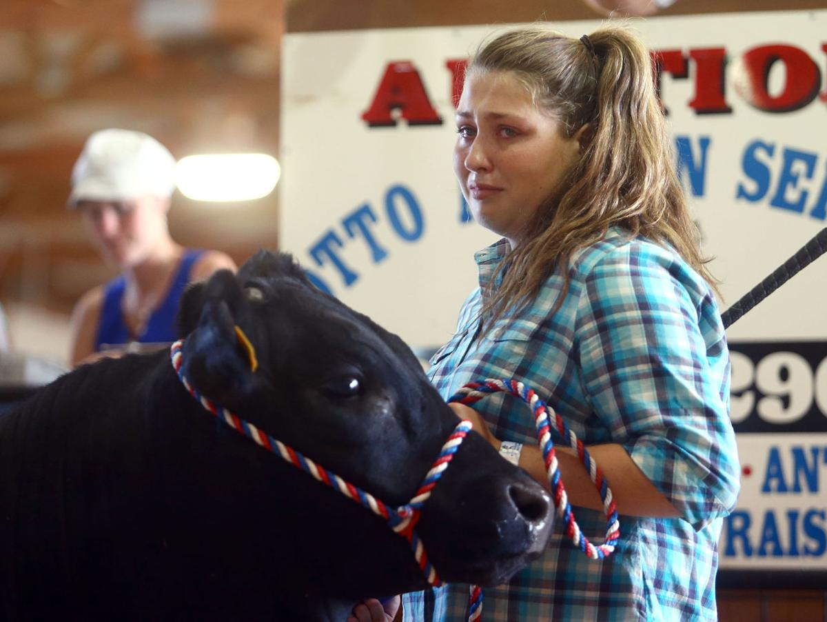 Livestock auction brings mixed emotions to 4 h participants local livestock auction thecheapjerseys Choice Image
