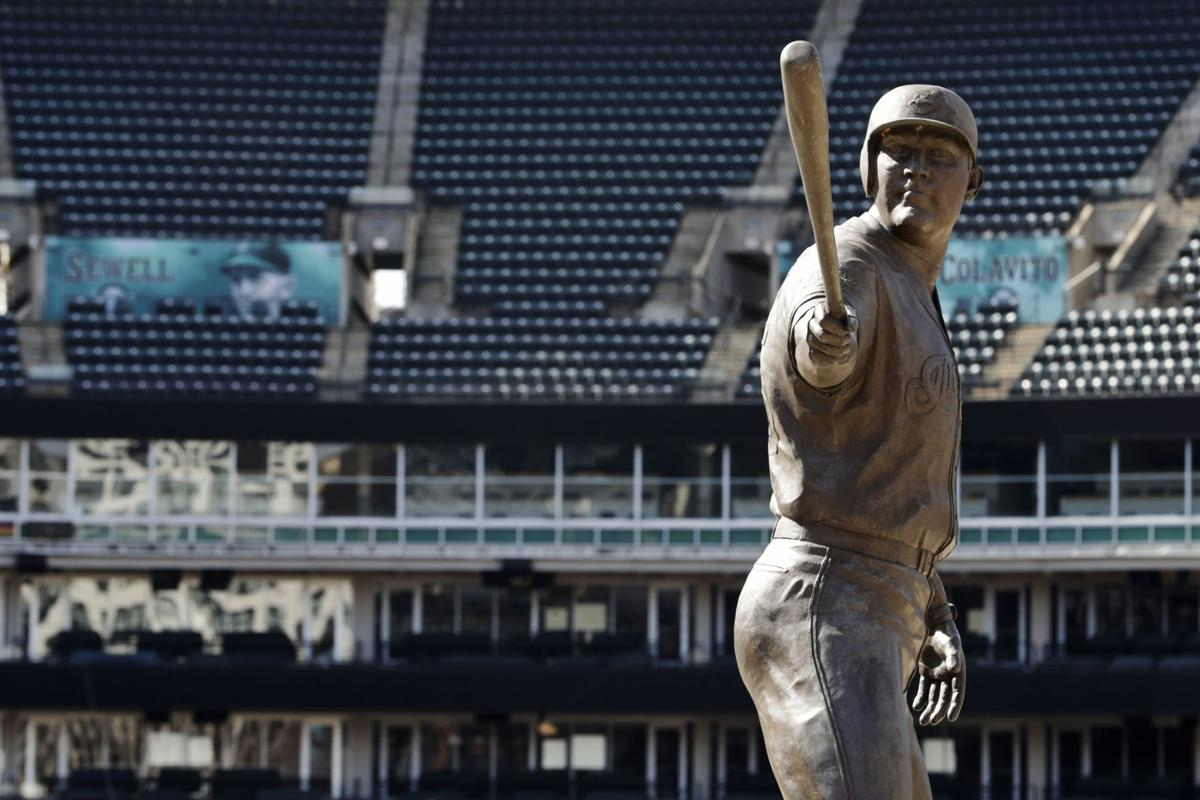 Pandemic in photos: Stadiums deserted as virus postpones baseball