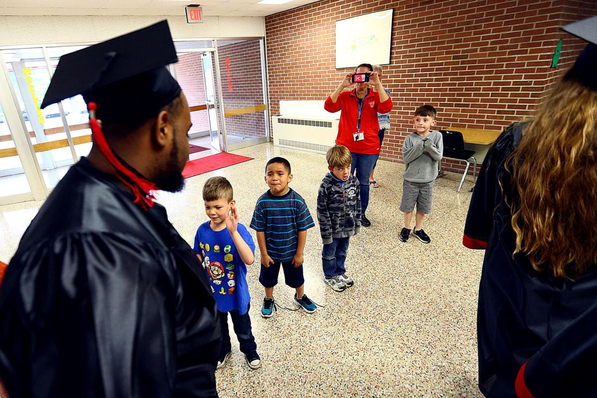 Taylor seniors return to elementary school in caps and gowns | Local ...