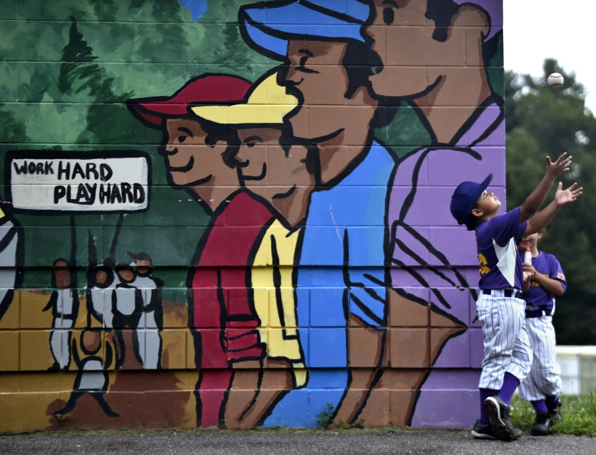 The Ques Little Leaguer Jeremiah Amaro catches a baseball after his game in the Hartford Northend 5-8 (year) Little League at Waverly Field on June 19, 2019.