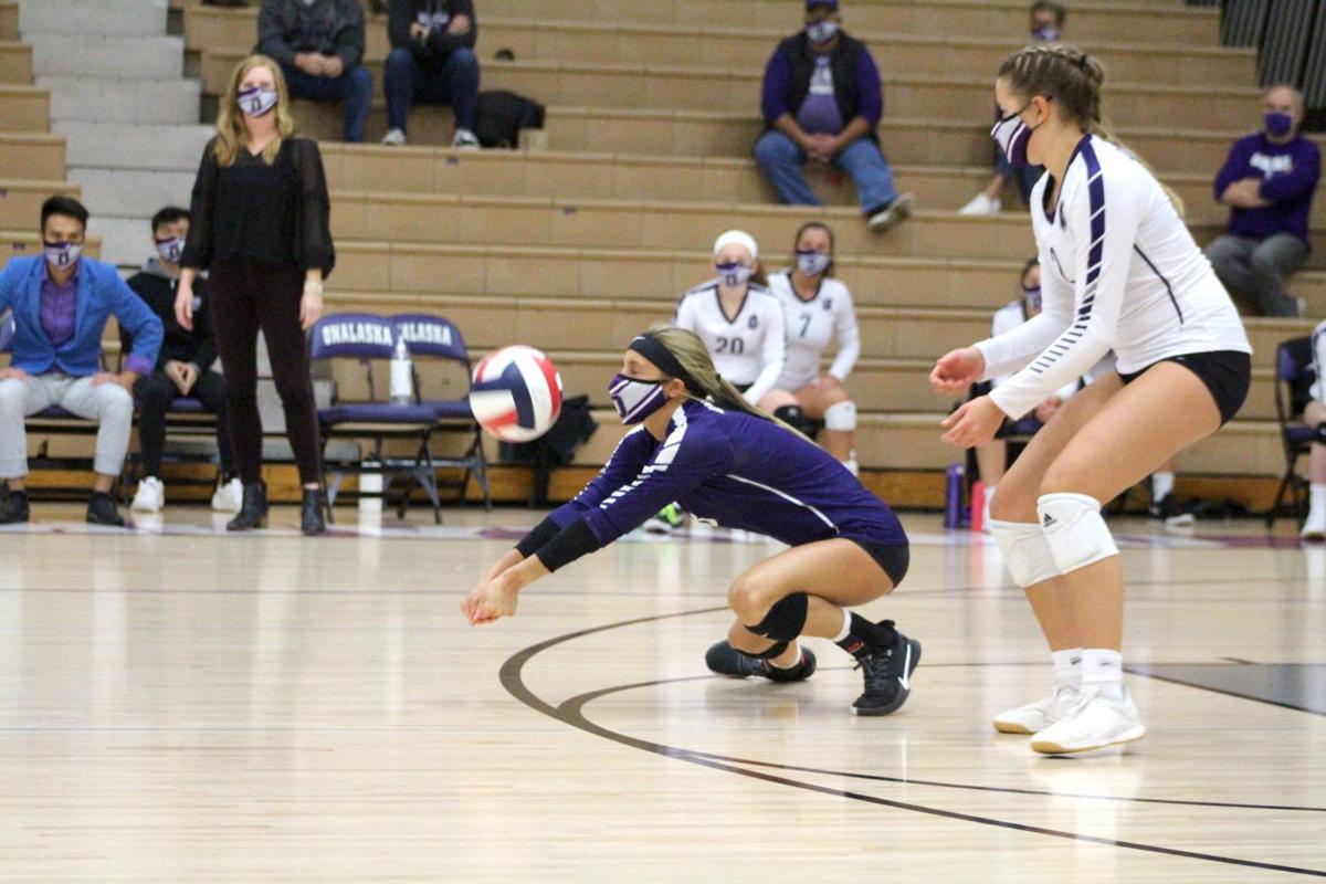 Olivia Gamoke digs a ball