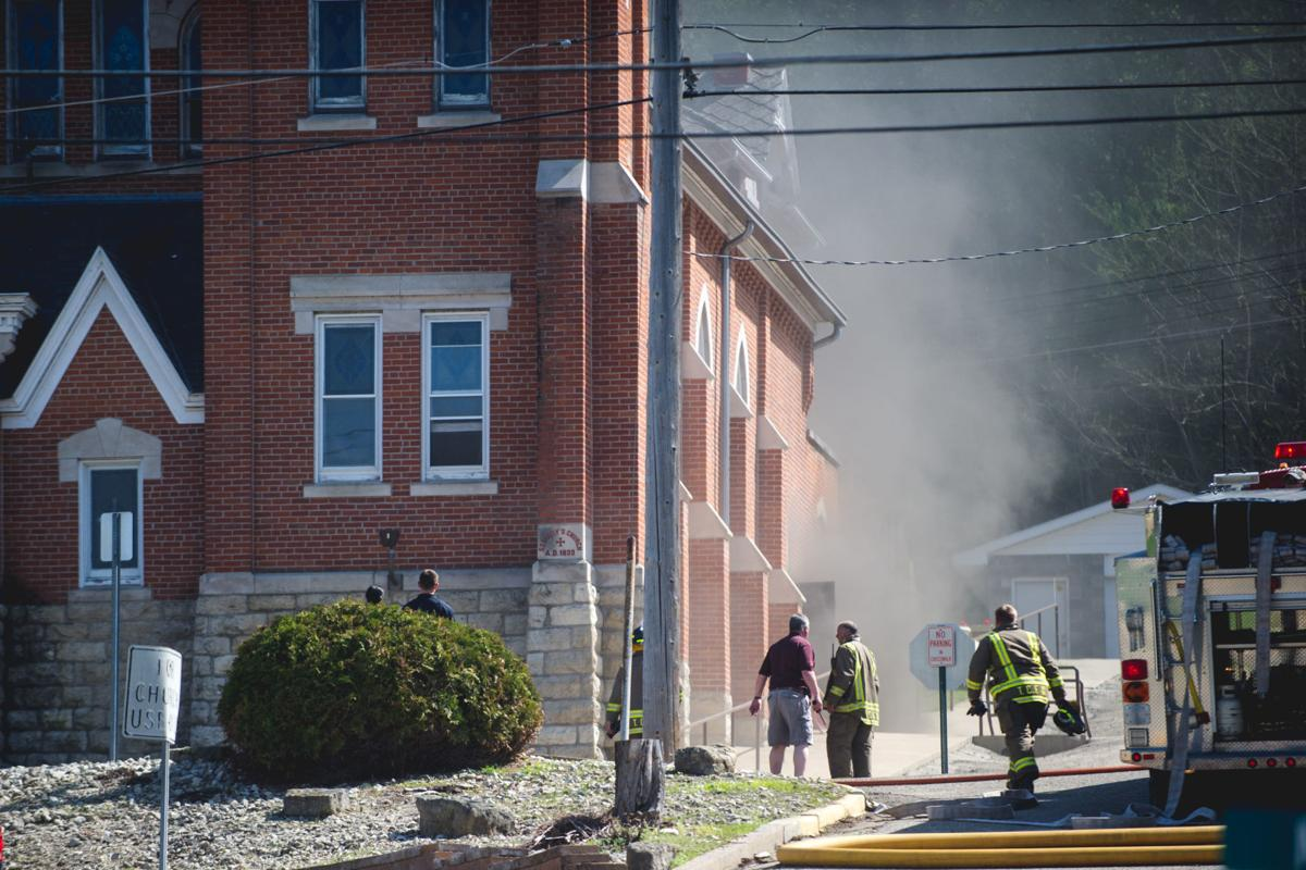 Firefighers work to contain blaze at Saint Mary's Immaculate Conception Church in Fountain City