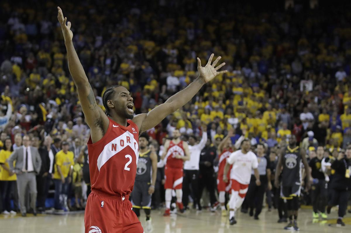Kawhi Leonard celebrates title, AP generic file photo