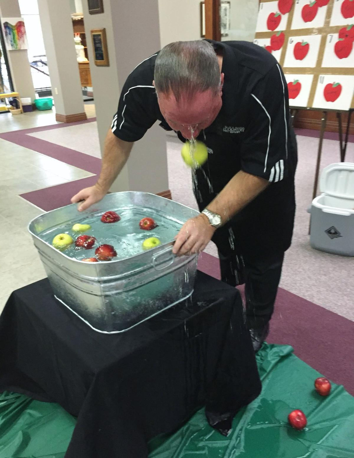 Black River Country Bank goes bobbing for apples for Friends Sharing Food