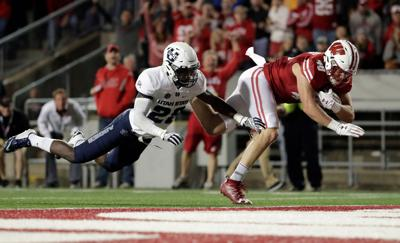 badgers football wisconsin flies past utah state after first half