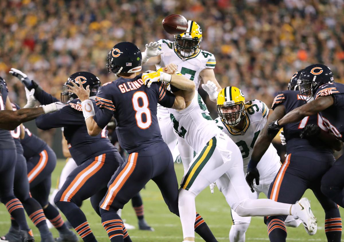 Clay Matthews strip sack of Mike Glennon, State Journal photo