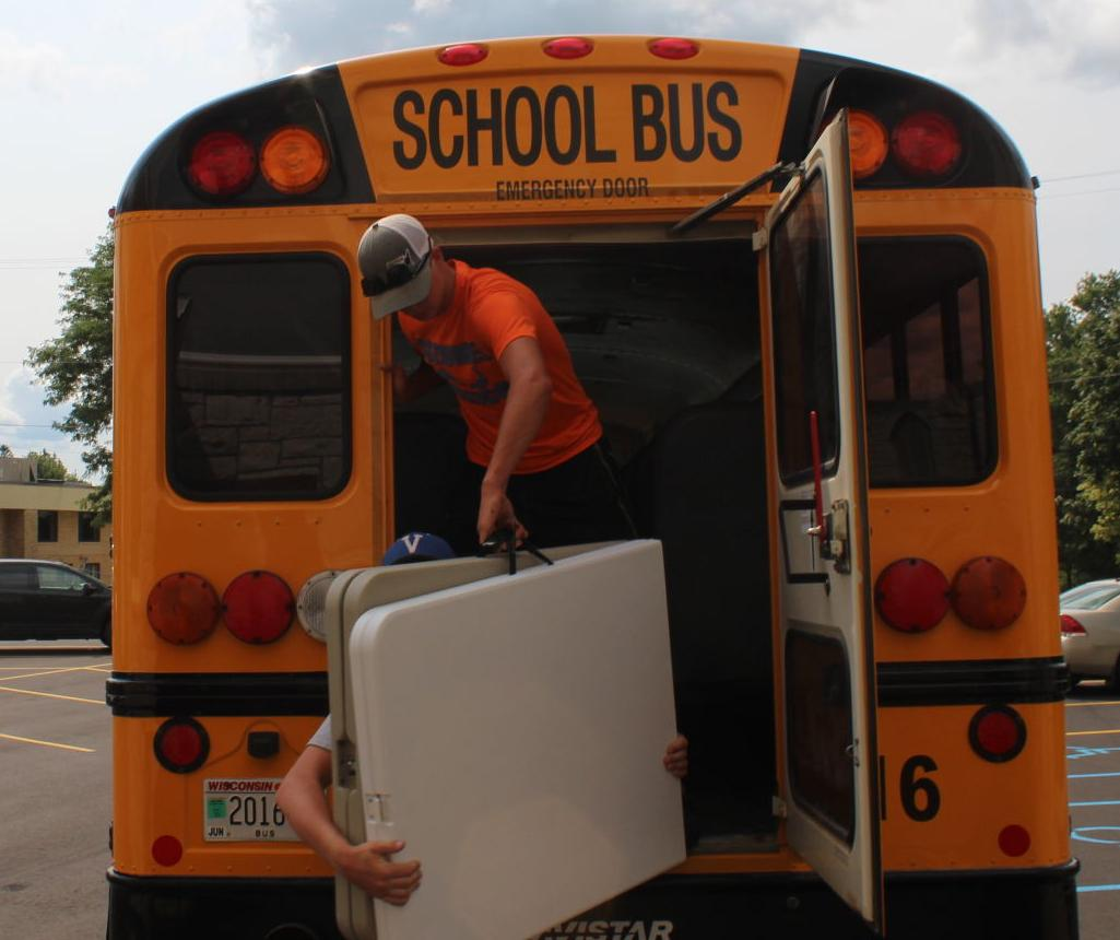 Football players volunteer for Stuff the Bus