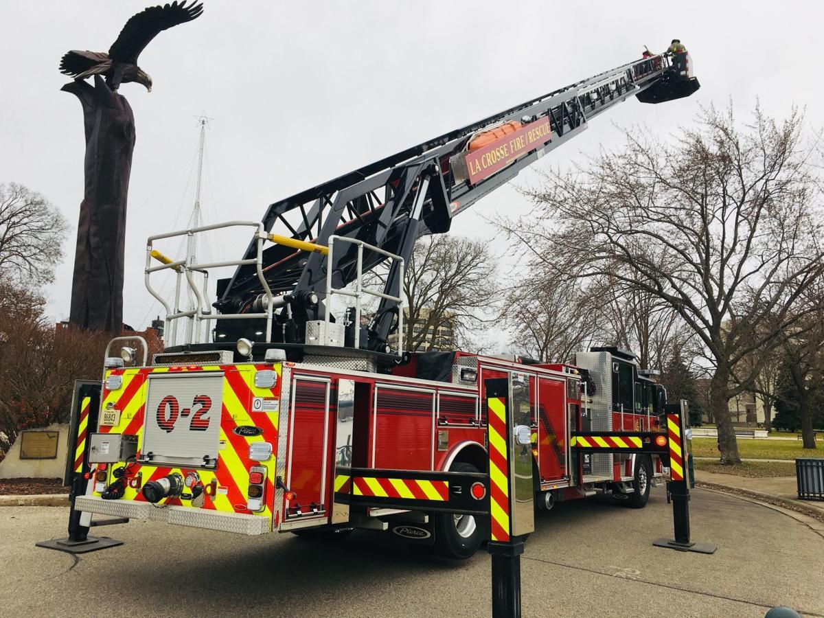 La Crosse firefighters help hang Rotary Lights
