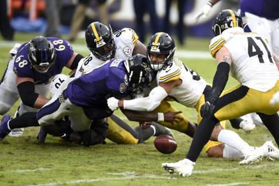 Lamar Jackson fumbles, AP photo
