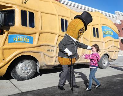 holmen shoppers greeted by the original spokesnut local