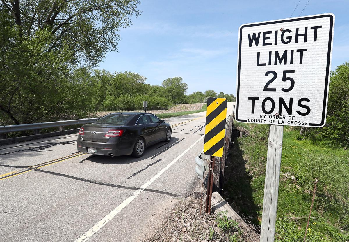 A Car Crosses Bridge Over Sour Creek On Hwy V Near Stevenstown Transportation Officials Have Lowered The Weight Limits Dozens Of Bridges Throughout