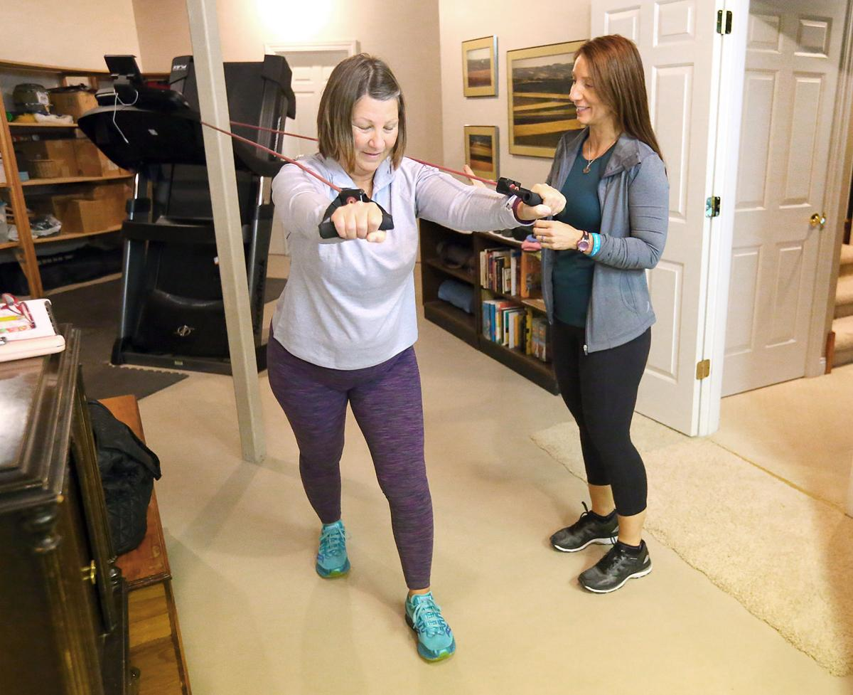 Cheryl Killilea trains client with pull weights