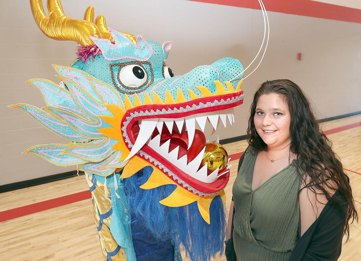 Big Blue Dragon Boat youth ambassador Vanessa Smith with dragon