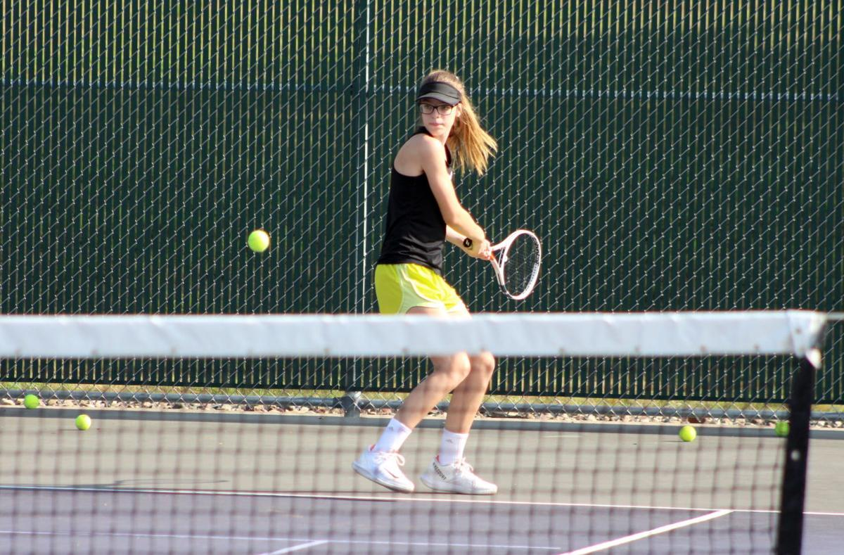 Willa Brown prepares to return a serve