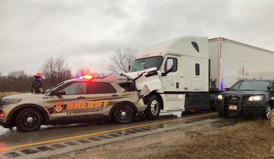 Semi strikes La Crosse County deputy's vehicle along Interstate 90