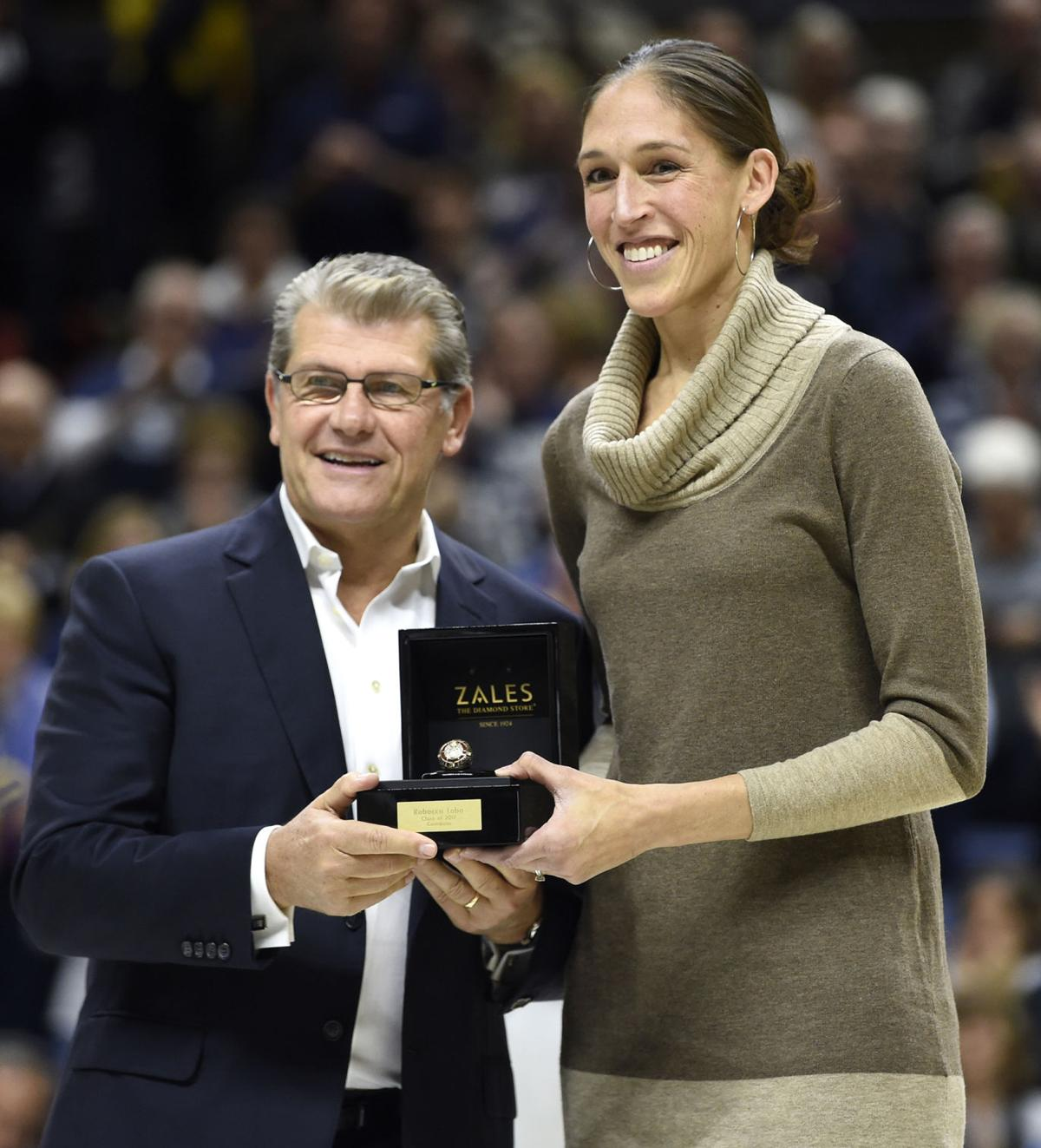 Rebecca Lobo is presented a Naismith Memorial Hall of Fame inductee ring by Connecticut head coach Geno Auriemma at Gampel Pavilion in Storrs, Conn., on November 17, 2017.