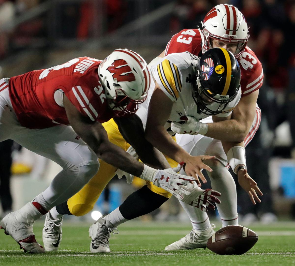 Leon Jacobs fumble recovery against Iowa, State Journal photo
