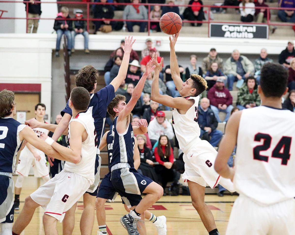 High school basketball: La Crosse Central throttles Hudson, with Badgers' coach Greg Gard watching