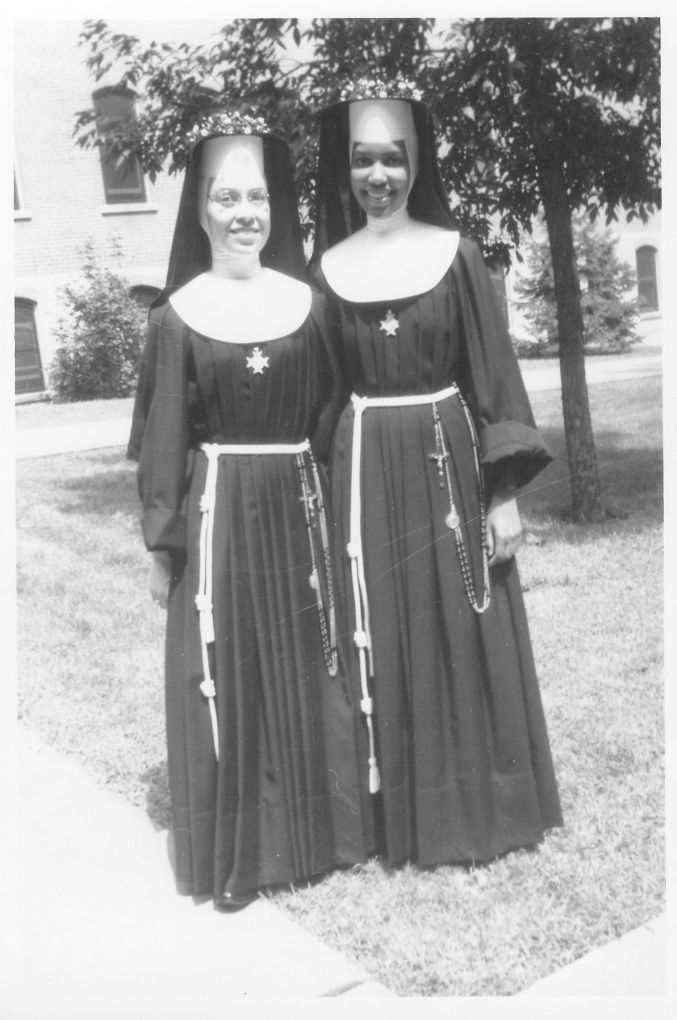Charlene and Thea in traditional garb