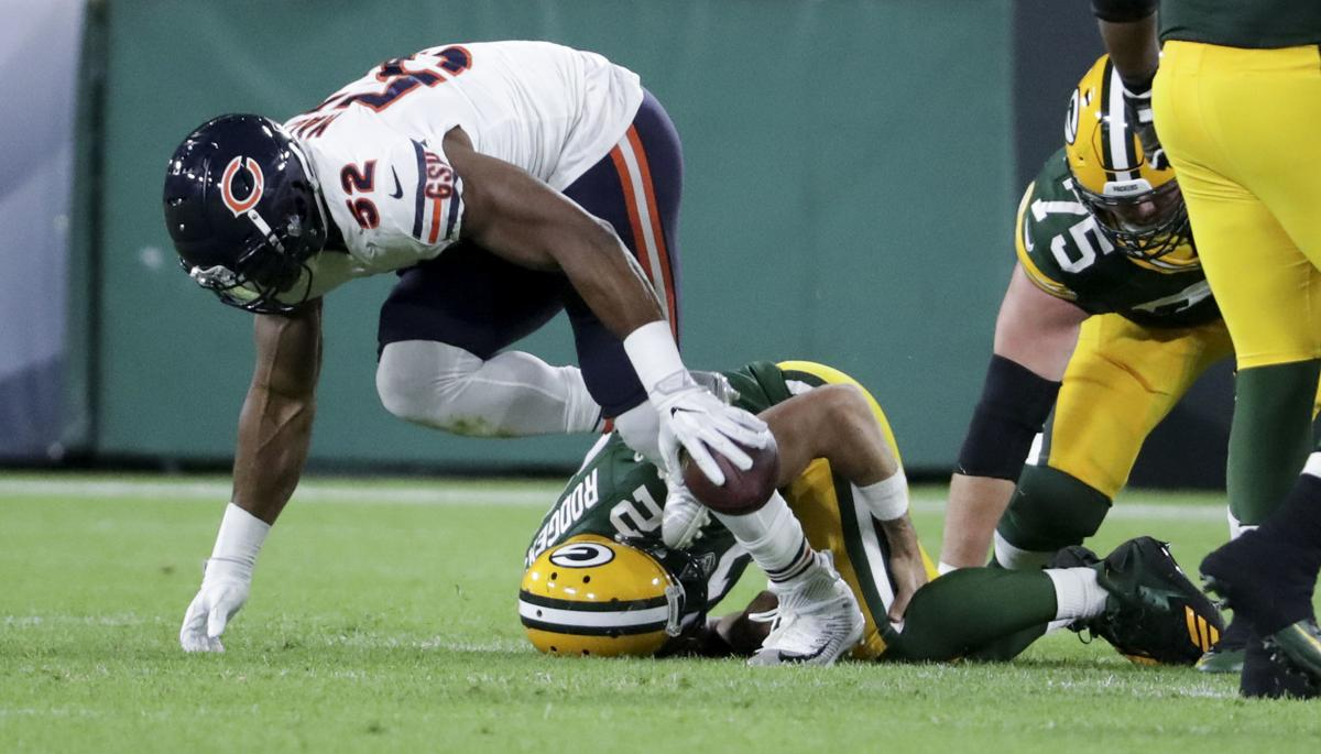 Aaron Rodgers injured, State Journal photo