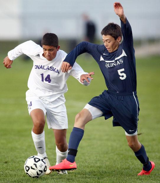 Aquinas vs. Onalaska soccer jump photo