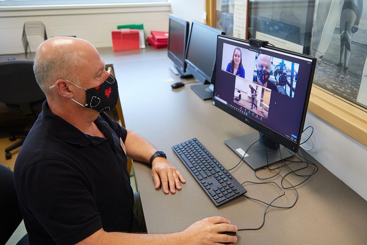 John Greany watches students
