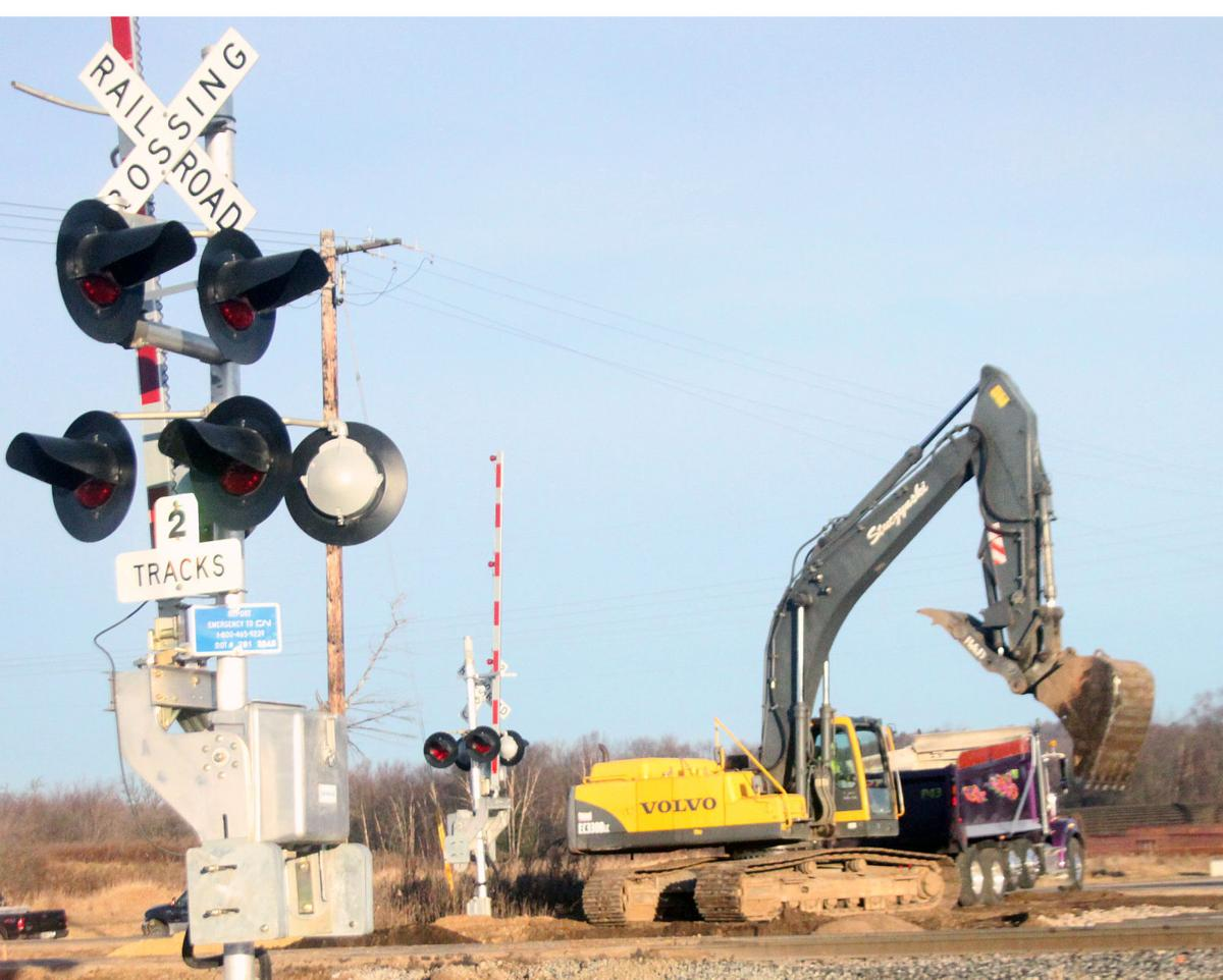 Railroad lines added to River Road intersection near Taylor