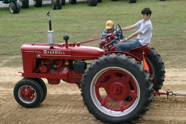 Grandfather and grandson at the tractor pull