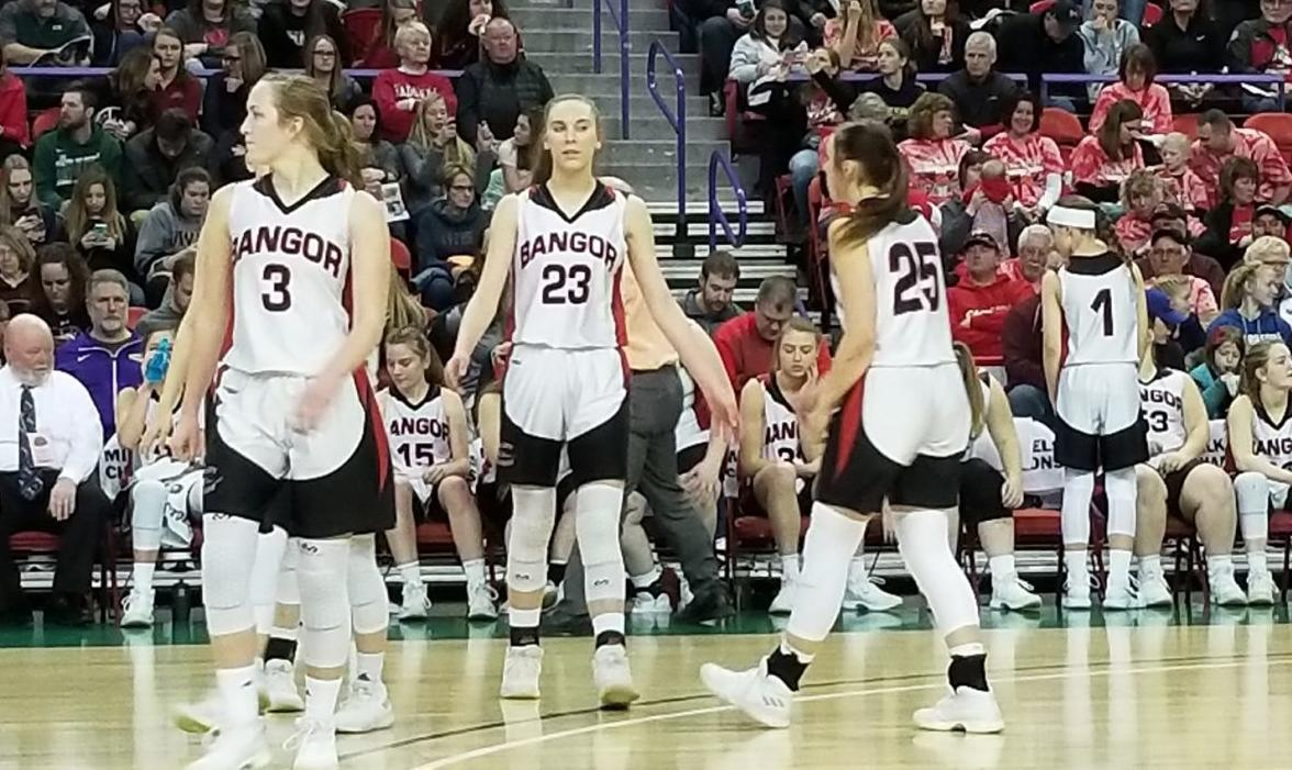 the bangor high school girls basketball team takes the floor after a timeout during a wiaa division 5 state semifinal game against clayton at the resch