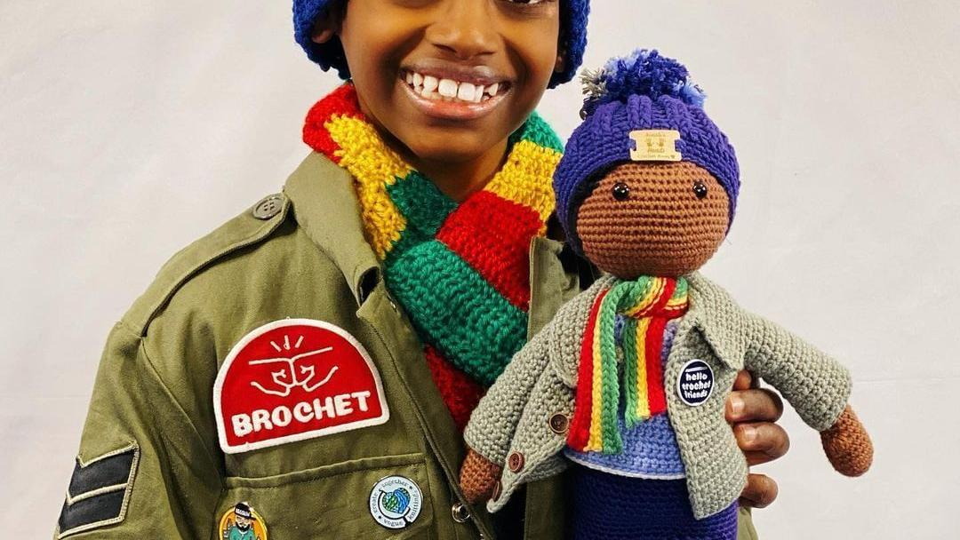 Crochet kid Jonah Larson auctioning doll in his likeness to benefit Roots Ethiopia